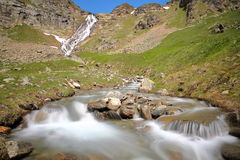 BONNEVAL-SUR-ARC, FRANCE: Waterfall and torrent above the hamlet L`Ecot, Vanoise National Park, Northern Alps. Waterfall and torrent above the hamlet L`Ecot Stock Photography
