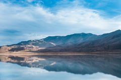 Bonneville Salt Flats, Tooele County, Utah, United States. Reflection of high mountains in water with blue, cloudy sky. Bonneville Salt Flats, Tooele County Royalty Free Stock Photos