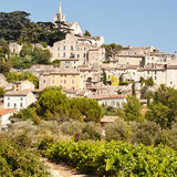 Bonnieux. The hill top village of Bonnieux in Provence with grape vines in the foreground Royalty Free Stock Photo