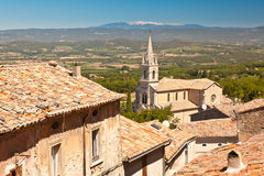 Bonnieux. Looking across Bonnieux church towards Mont Ventoux Stock Image
