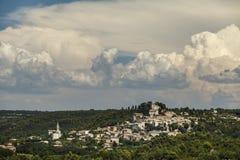 Bonnieux beautiful village under Cumulonimbus Royalty Free Stock Photos