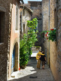 Bonnieux. FRANCE - JUL 11, 2014: Tourists on the narrow street of the beautiful medieval village of .  village is included in list of The most beautiful Stock Photos