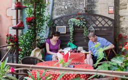 People read books at typical provence cafe. Provence region. France royalty free stock photography