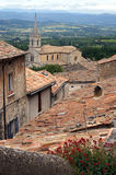 Bonnieux in the Provence. Village Bonnieux situated on a hill in the Provence, France with view to the mountain Mont Ventoux Stock Images