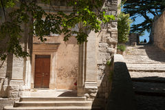 Bonnieux steps. A view up the steps in Bonnieux looking into a small courtyard with old door Stock Photo