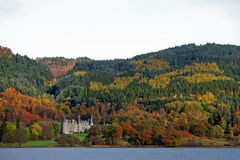 Bonny Scotland in the Autumn. Scotland - The Trossachs - Loch view with hotel and full Autumn colours Stock Images