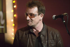 "Bono. Came down to the The Living Room in New York to sing a song with his fellow songwriter Glen Hansard, last Tuesday May 8th. They both sang  ""The Auld Stock Photo"