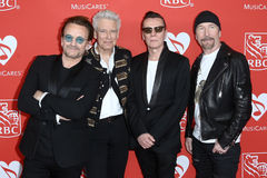 Bono, Adam Clayton, Larry Mullen Jr, The Edge. L-R Bono, Adam Clayton, Larry Mullen Jr, and The Edge attend the 13th Annual MusiCares MAP Fund Benefit Concert at stock photography