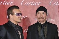 Bono & The Edge. PALM SPRINGS, CA - JANUARY 4, 2014: Bono (left) & The Edge, from U2, at the 2014 Palm Springs International Film Festival Awards gala at the stock photography