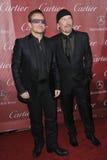 Bono & The Edge. PALM SPRINGS, CA - JANUARY 4, 2014: Bono (left) & The Edge, from U2, at the 2014 Palm Springs International Film Festival Awards gala at the royalty free stock photos