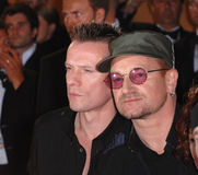 Bono,Larry Mullen,U 2,U2. U2 stars Bono & Larry Mullen performing on the steps of the Palais des Festivals prior to the screening of their new movie U2 3D at the royalty free stock photography