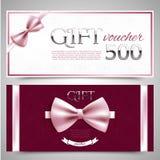 Bons de cadeau avec les arcs décoratifs Photographie stock libre de droits