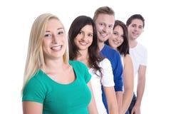 Bons trabalhos de equipa - estagiários felizes em seguido isolados no backgr branco Imagem de Stock