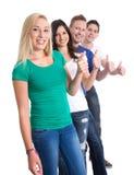 Bons trabalhos de equipa - os polegares levantam e feliz isolados no fundo branco Imagens de Stock Royalty Free