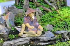 A bonsai fisherman. In the garden Stock Photos