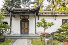 Bonsai and house in Duojing garden Royalty Free Stock Photos