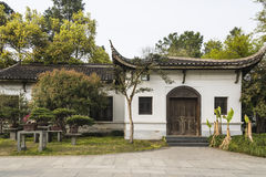 Bonsai and house in Duojing garden Royalty Free Stock Images