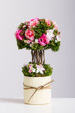 Bonsai tree artificial flowers red and pink stock images