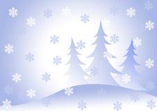 Bont-bomen onder een sneeuwval. royalty-vrije stock afbeelding