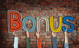 Bonus and Brick Wall in the Background Stock Images