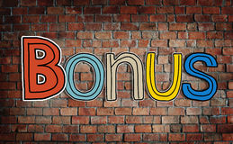 Bonus and Brick Wall in the Background Royalty Free Stock Photos