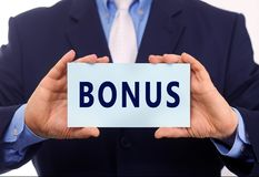 Bonus. Business man hold paper bonus text on it stock images