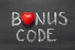 Bonus code. Phrase handwritten on chalkboard with heart symbol instead of O stock photography