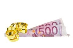 Bonus payment. Isolated roll of 2 five hundred Euro banknotes decorated as a gift royalty free stock photos