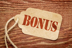 Bonus sign  on a paper price tag Royalty Free Stock Photo