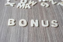 BONUS word of wooden alphabet letters. Business and Idea royalty free stock images