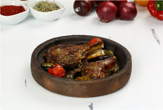 Bony Meat stew in ceramic hot pot. Bony meat stew with vegetables in a hot pot stock images