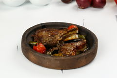 Bony Meat stew in ceramic hot pot. Bony meat stew with vegetables in a hot pot royalty free stock images