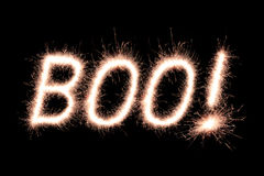 Boo!. Halloween Message Boo! written with Sparkle firework over black background royalty free stock photo