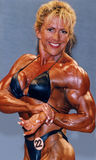 Boobs and Biceps. English professional female bodybuilder Gayle Moher demonstrates her awesome, powerful physique with a side-chest pose, particularly flattering stock photography