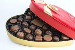 Boog, doos en chocolade stock fotografie