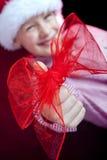 Boog op de duim van de Kerstmisjongen Stock Fotografie