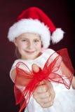 Boog op de duim van het Kerstmismeisje Stock Afbeeldingen