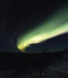 Boog van noordelijke lichten in de hemel stock afbeeldingen