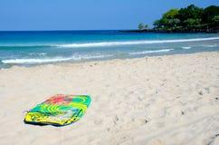Boogie board abandoned on a sand at Kaunaoa beachr Stock Photos