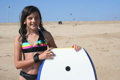Boogie Boarding. Girl standing on the beach with her boogie board Stock Photography