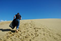 Boogie boarding. Man going to do boogie boarding Royalty Free Stock Image