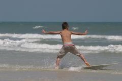 Boogie boarding. Young boy on boogie board Royalty Free Stock Images