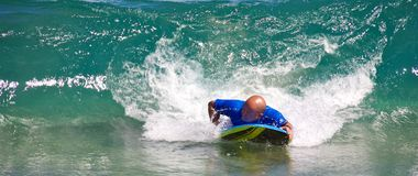 Boogie boarding. A man Boogie Boarding on large waves at D.T. Fleming Beach Park in Lahaina, Maui, Hawaii Royalty Free Stock Photography