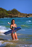 Boogie Boarding on Maui. A woman posing with her boogie board on a maui beach Stock Images