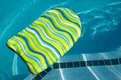 Boogie Kick Board in Swimming Pool Royalty Free Stock Photography
