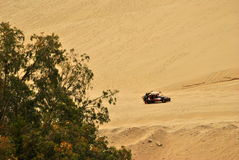 Boogie ride. Boogie riding along the sand dunes at peruvian's desert in Ica royalty free stock photography