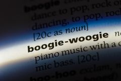 Boogie-woogie. Word in a dictionary.  concept royalty free stock photo
