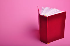 Book. Open empty book on pink background Stock Photo