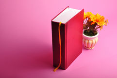 Book. A hard cover big red book with flower pot Royalty Free Stock Images