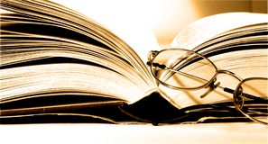 Book. With eyeglasses Stock Photography